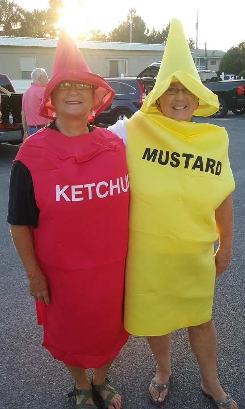 Ministry to the Community Two friendly ladies dressed at Ketchup and Mustard bottles