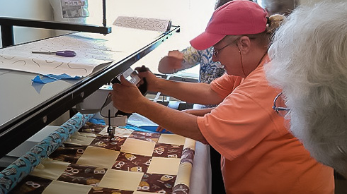 Long Arm Quilt machine in action