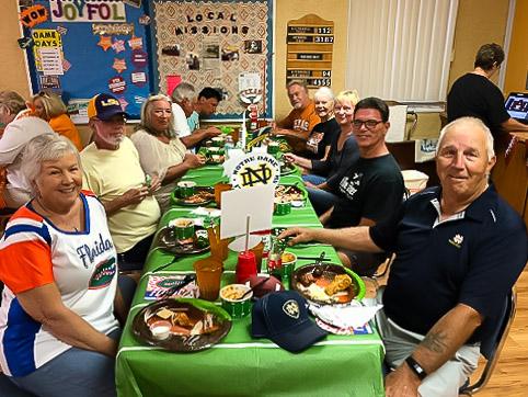 Group enjoying tailgate dinner