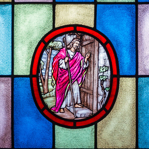Stained Glass Art of Jesus Knocking on a Door